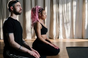 Photo of a couple meditating together